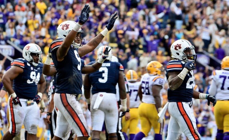 Jamien Sherwood (9) and Jeremiah Dinson (20) celebrate a defensive stop during Auburn football at LSU on Oct. 26, 2019, in Baton Rouge, La. LSU won, 23-20.