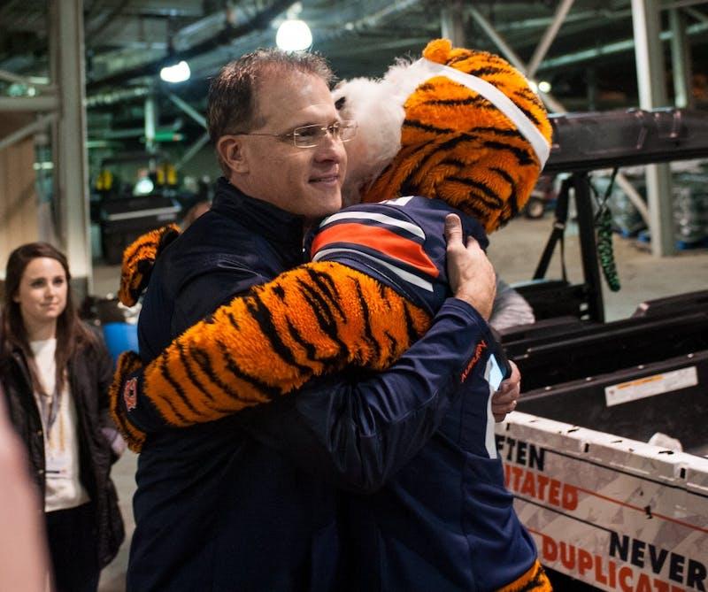 Aubie give head coach Gus Malzahn a hug after the game. Auburn vs Alabama on Saturday, Nov. 25 in Auburn, Ala.