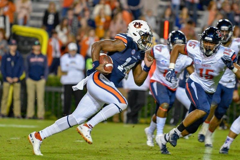 Malik Willis (14) runs the ball during Auburn Football vs Liberty on Saturday,  Nov. 17, 2018, in Auburn, Ala.