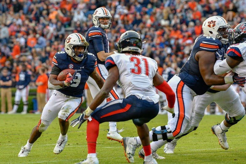 Kam Martin (9) runs the ball during Auburn Football vs Liberty on Saturday,  Nov. 17, 2018, in Auburn, Ala.