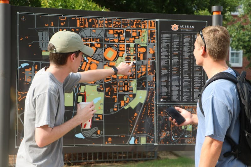 Auburn University students use campus maps during the first week of school in Auburn, Ala.