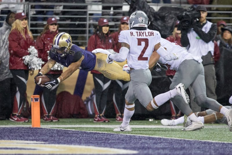 Washington running back Myles Gaskin (9) dives for the pylon to score his third touchdown of the game in the Huskies' 41-14 win over Washington State in the Apple Cup on Nov. 25, 2017, in Seattle, Washington. Contributed by the UW Daily sports desk.