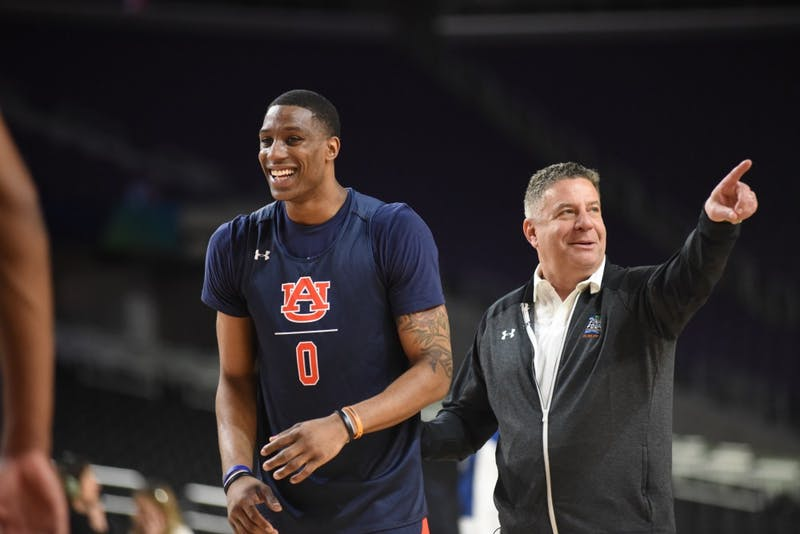 Horace Spencer (0) and Coach Bruce Pearl laugh during practice on Friday, April 5, 2019, in Minneapolis, Minn.