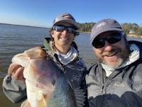 Joe Durham (right) poses with Tucker Smith of Auburn's bass fishing team.