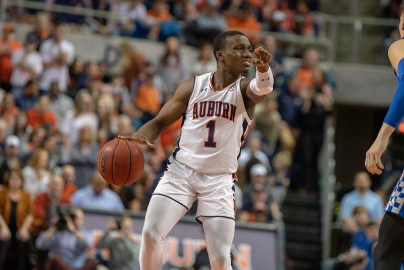 Jared Harper (1) directs his teammates during Auburn Basketball vs. Kentucky, on Saturday, Jan. 19, 2019 in Auburn, Ala.