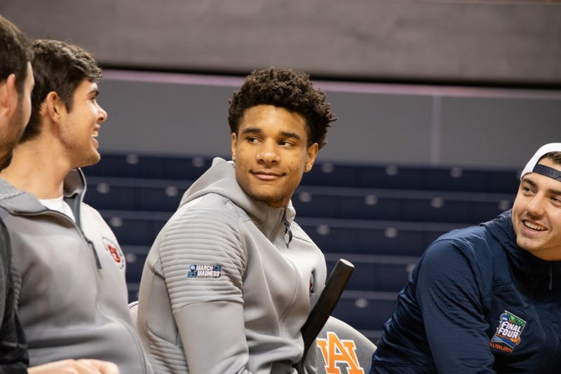 Chuma Okeke smiles during Auburn's welcome back ceremony in Auburn Arena on April 7, 2019, in Auburn, Ala.