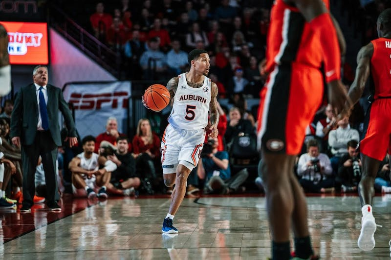 J'Von McCormick (5) dribbles during Auburn basketball at Georgia on Feb. 19, 2020, in Athens, Ga. Photo via Dylan Baker / Auburn Athletics