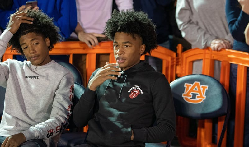 5-star Auburn signee Sharife Cooper (right) watches the court during Tipoff at Toomer's, on Thursday, Oct. 17, 2019, in Auburn, Ala.