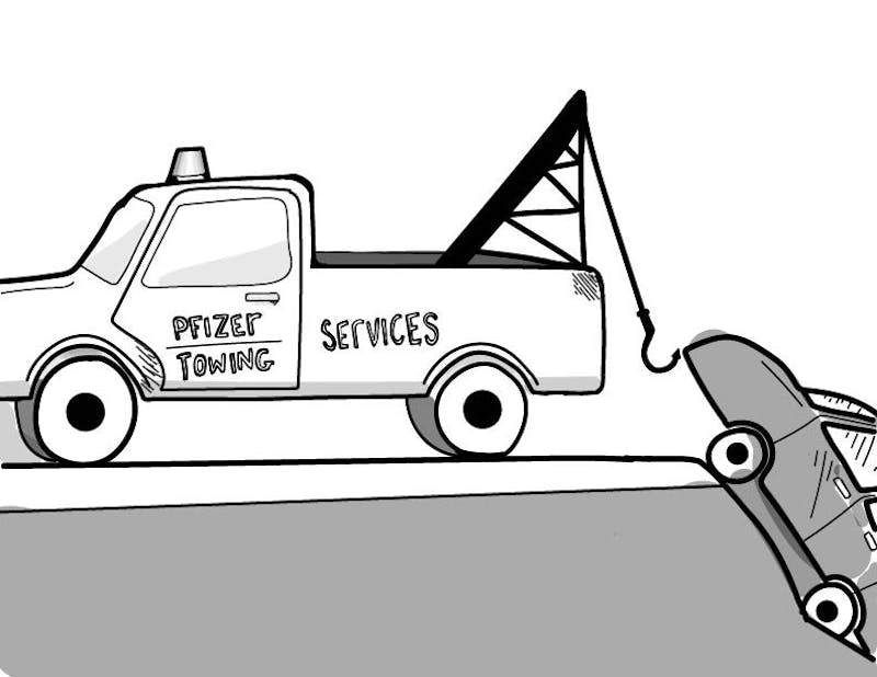 A tow truck reading 'Pfizer Towing Services' pulls a car from a ditch.