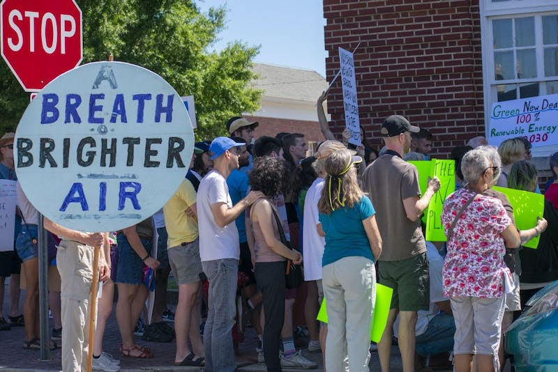 Protesters meet outside Opelika Federal building to raise awareness of climate change Sept. 20, 2019.