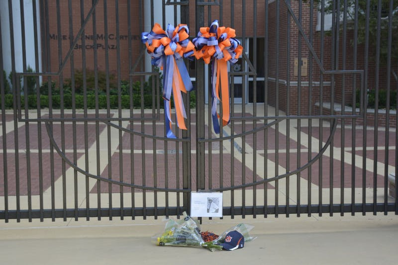 Bouquets of flowers and an Auburn baseball cap lie outside Gate 10 of Jordan-Hare Stadium in memory of Pat Dye on June 2, 2020 in Auburn, Ala.