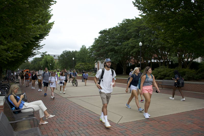 Students walk down the Haley Concourse on Aug. 16, 2021, the first day of fall classes at Auburn University.