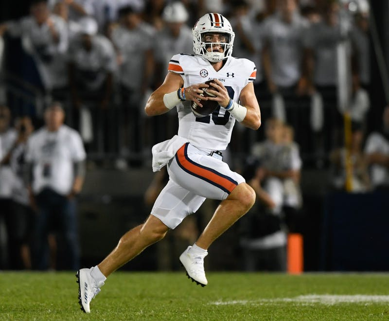 Sep 18, 2021; University Park, PA, USA; Bo Nix (10) carries the ball between Auburn and Penn State at Beaver Stadium. Mandatory Credit: Todd Van Emst/AU Athletics