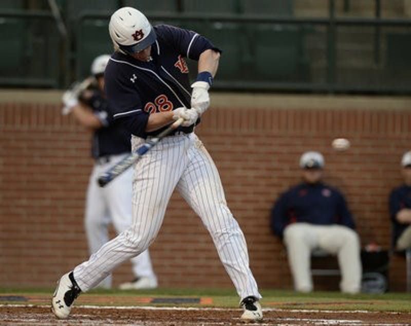Auburn's Garrett Cooper hits a home run in the 4th inning. (Courtesy of Todd Van Emst / AUBURN ATHLETICS PHOTOGRAPHER)