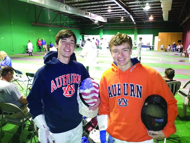 Jay Parcelewicz and Jack Armistead  compete at a fencing tournament.