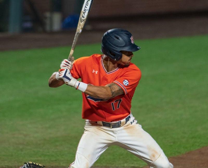 Will Holland (17) prepares to swing at the ball during Auburn Baseball vs. Cincinnati on Saturday, March. 2, 2019, in Auburn, Ala.