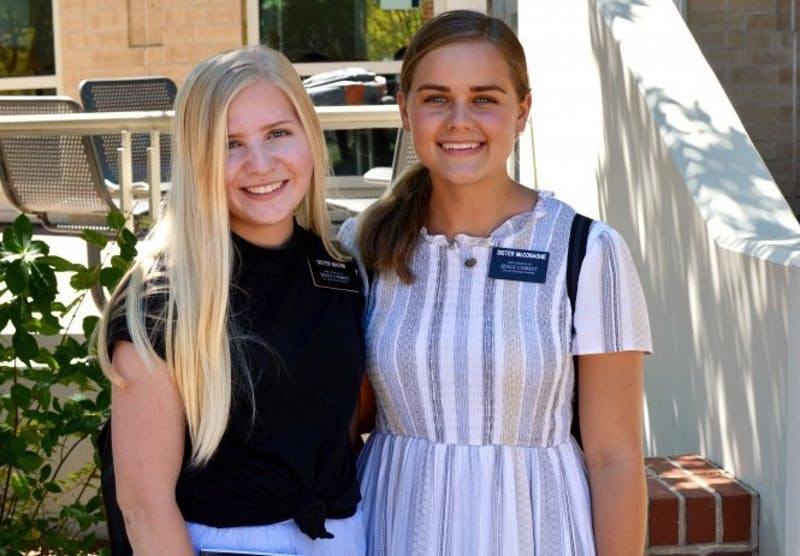 Sisters Kelsey Bacon and Lexy McConaghie serve in Auburn, Ala.