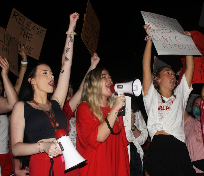 Students protest Auburn University's response to sexual assault on Toomer's Corner on Tuesday, Sept. 14, 2021, in Auburn, Ala.