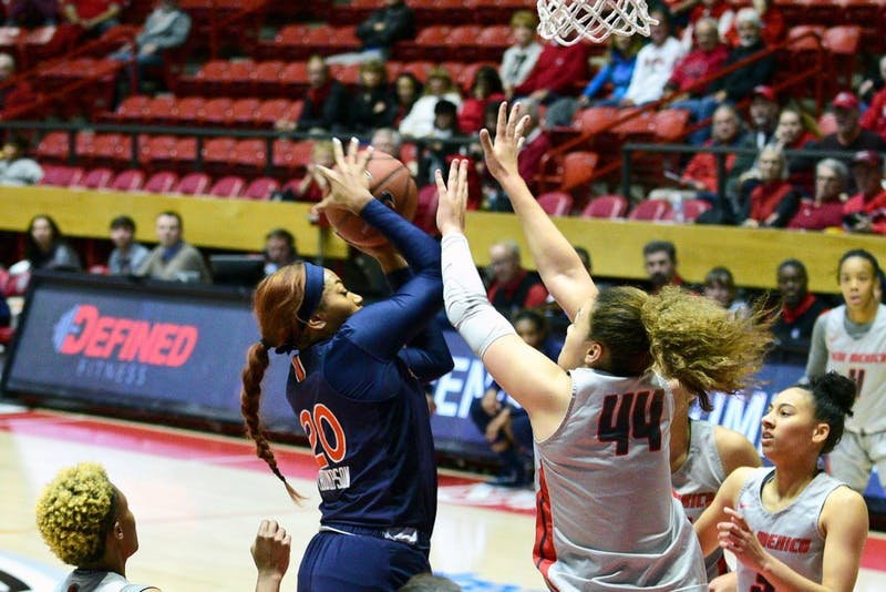 Unique Thompson (20) grabs the rebound in Auburn women's basketball vs. New Mexico on Sunday, Nov. 11, 2018, in Albuquerque, N.M..