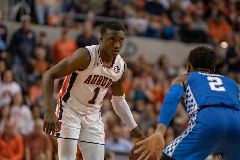 Jared Harper (1) looks for a teammate to pass to during Auburn Basketball vs. Kentucky, on Saturday, Jan. 19, 2019 in Auburn, Ala.
