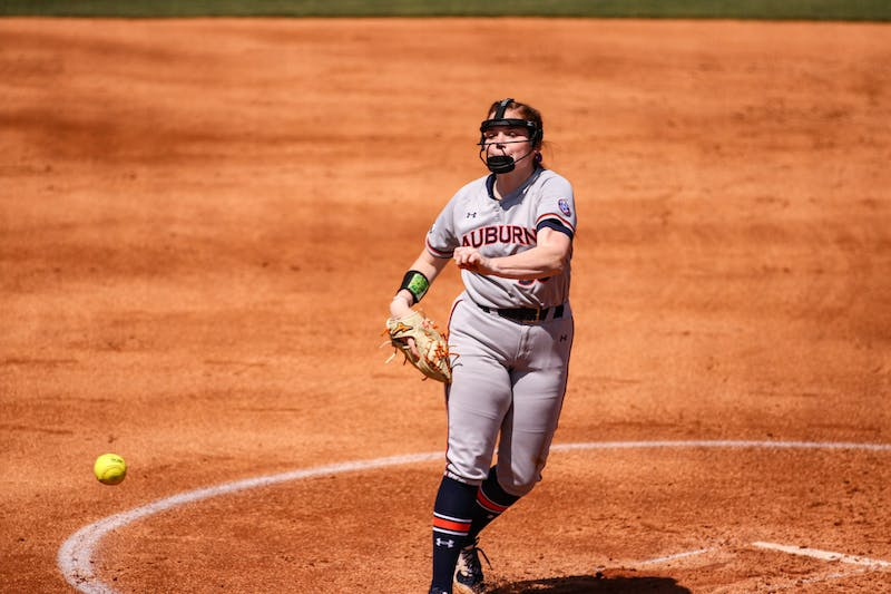 Shelby Lowe (55) pitches the ball during the game between Auburn and Arkansas at Jane B. Moore Field on April 3, 2021; Auburn, AL, USA. Photo via: Jacob Taylor/AU Athletics