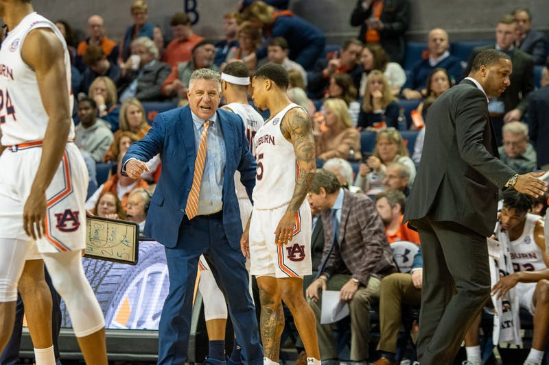 Auburn Coach Bruce Pearl speaks to J'Von McCormick (5) during Auburn Men's Basketball vs LSU, on Saturday, Feb. 8, 2020, in Auburn, Ala.