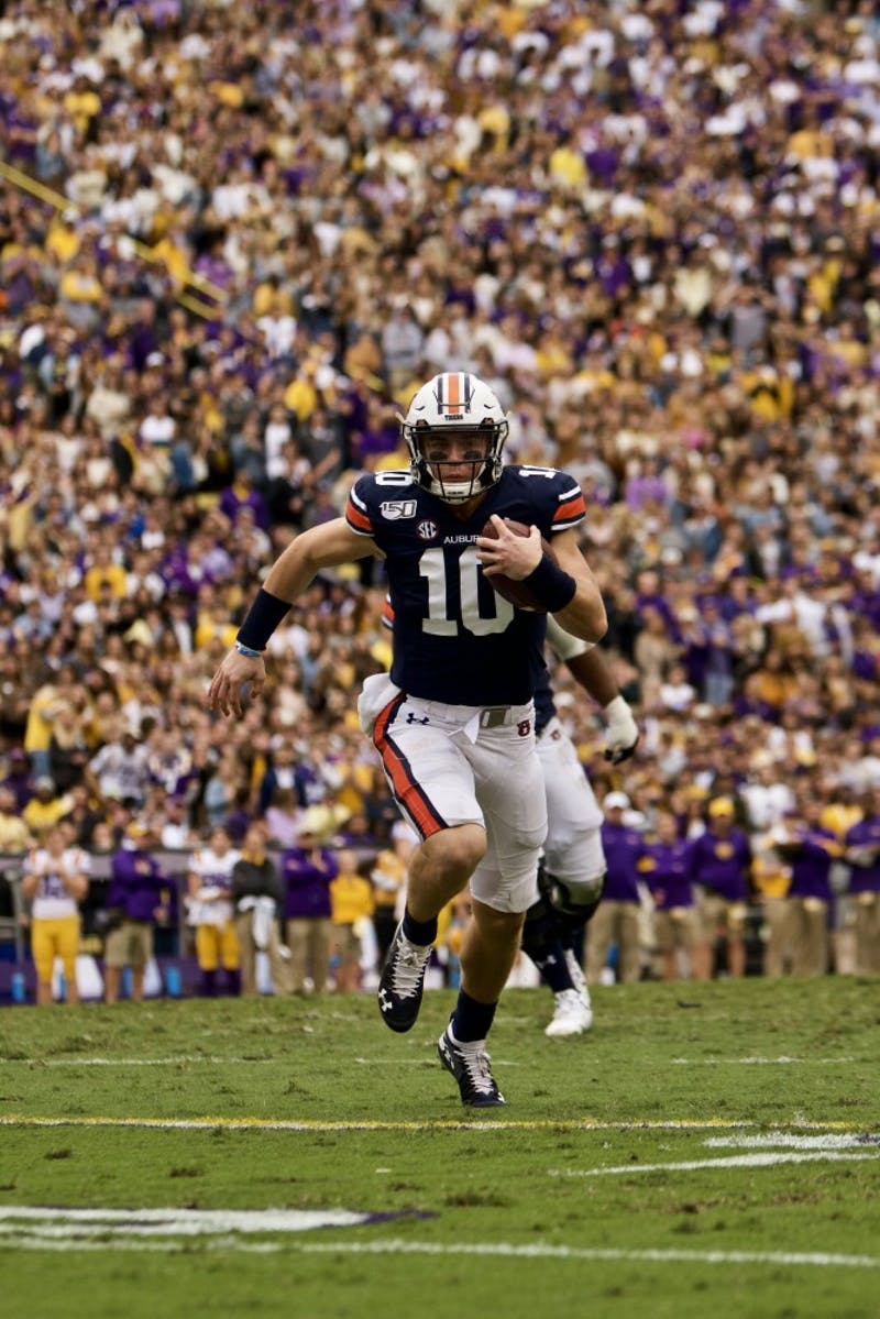 Bo Nix (10) runs the ball during the Auburn vs. LSU game Saturday Oct. 26, 2019, in Baton Rogue, La.