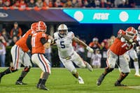 Jake Fromm (11) looks for receivers as Derrick Brown (5) charges during Auburn Football vs. Georgia on Saturday, Nov. 10, 2018, in Athens, Ga.