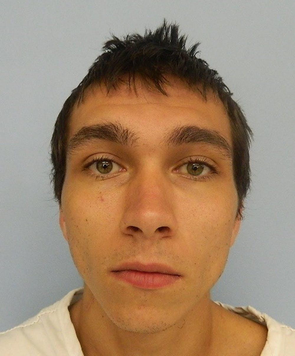 Auburn man arrested on charges of breaking and entering a vehicle and theft