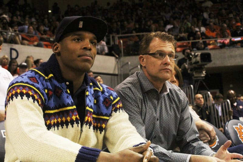 Head Coach, Gus Malzahn and former Auburn quarterback, Cam Newton, watch as Auburn takes on Alabama on February 6, 2013. (Katherine McCahey / ASSISTANT PHOTO EDITOR)