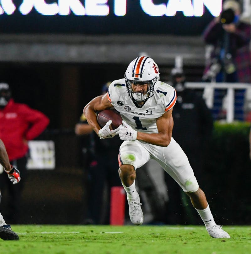 Anthony Schwartz (1) runs after the catch during the game between Auburn and Georgia at Samford Stadium on Oct 3, 2020; Athens, GA, USA. Photo via: Todd Van Emst/AU Athletics