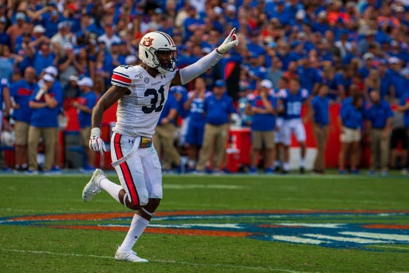 Chandler Wooten (31) runs off the field celebrating a play during Auburn vs. Florida, on Saturday, Oct. 5, 2019, in Gainesville, Fla.