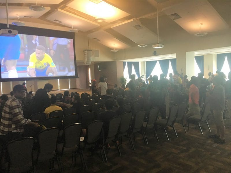A crowd of students watches the Brazil- Belgium quarter-final match of the Fifa World Cup in the Student Center Ballroom on Friday, July 6, 2018, in Auburn, Ala.