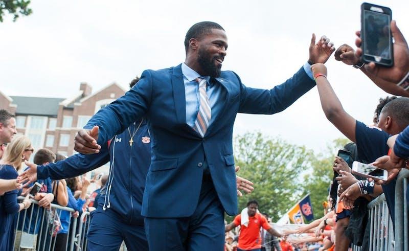 Auburn linebackers coach Travis Williams greets fans at Tiger Walk. Auburn vs Mississippi State on Saturday, Sept. 30 in Auburn, Ala.