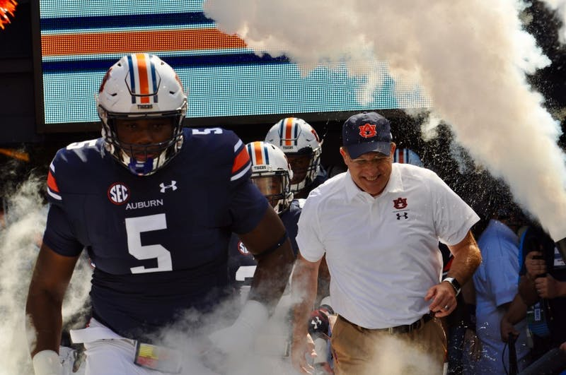 Derrick Brown (5) and Gus Malzahn running out of the tunnel during Auburn Football vs. LSU on Saturday, Sept. 15, 2018 in Auburn, Ala.