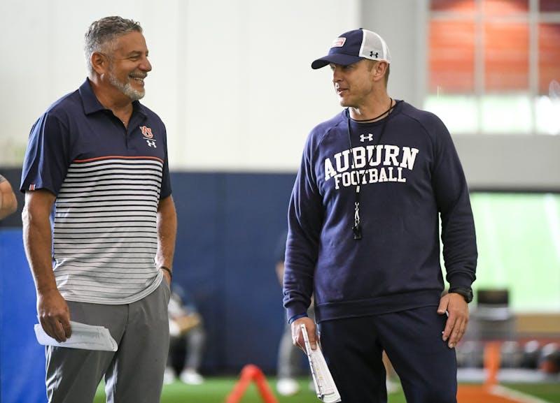 Coach Bruce Pearl talks to Coach Bryan Harsin before practice Saturday.Auburn practice/scrimmage on Saturday, April 10, 2021 in Auburn, Ala.Todd Van Emst/AU Athletics