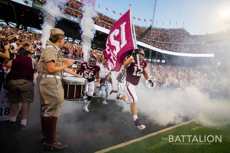 Texas A&M takes the field led by The 12th Man. Photo courtesy: Meredith Seaver/The Battalion.