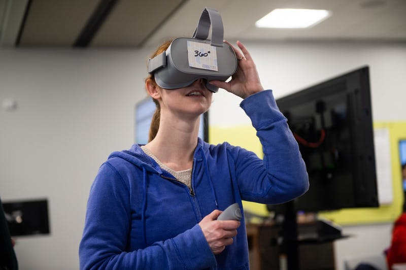Student interacts with virtual reality headset at the Biggio Center.