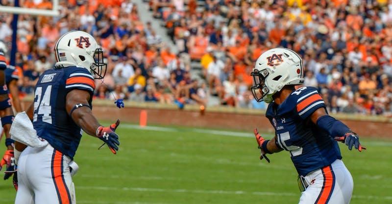 Daniel Thomas (24) high-fives Jordyn Peters (15) during Auburn football vs. Southern Miss on Sept. 29, 2018, in Auburn, Ala.