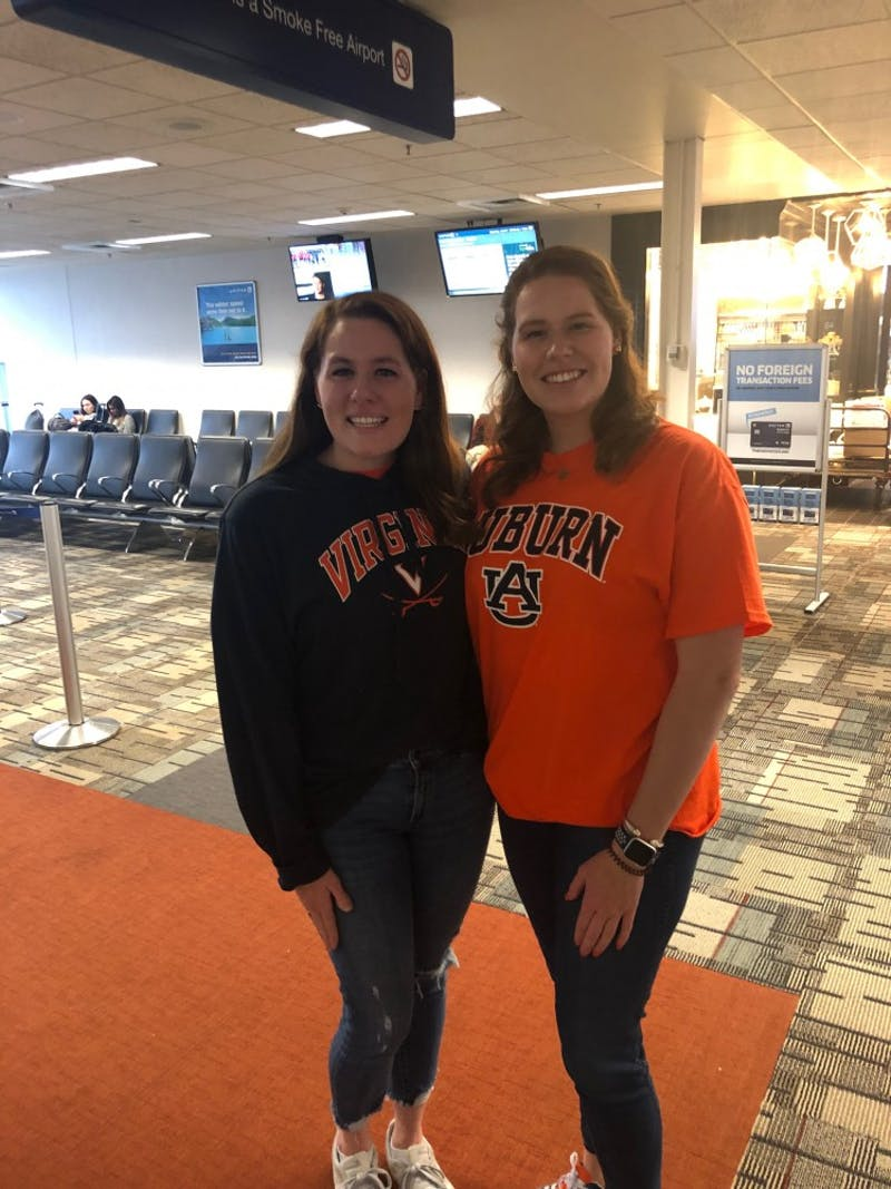 Kate and Courtney Anne Nappi dressed in their respective school attire as they arrive in Minneapolis to attend the Final Four matchup between Auburn and Virginia on Saturday, April 6, 2019.