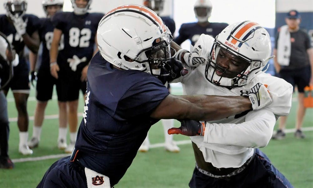 Spring practice notebook: Tempers flare during physical drills; Wildcat candidates; QBs punting