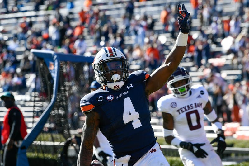 Tank Bigsby (4) celebrates after a big run to get Auburn inside the 10-yard line during the game between Auburn and Texas A&M at Jordan Hare Stadium on Dec. 5, 2020; Auburn AL, USA. Photo via: Todd Van Emst/AU Athletics