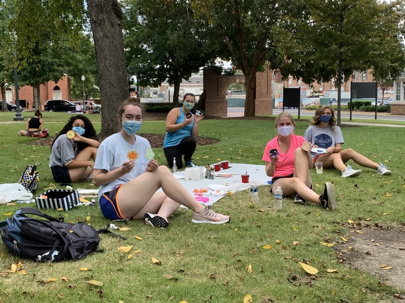 Students involved in Get Plugged In meet outdoors for small group events like arts and crafts to socialize safely.