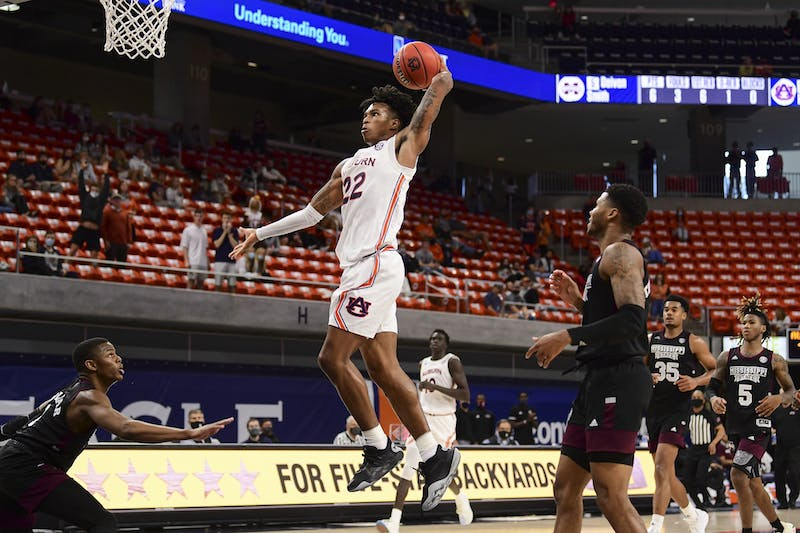 Mar 6, 2021; Auburn, AL, USA; Auburn Tigers guard Allen Flanigan (22) goes up for a dunk during the game between Auburn and Mississippi State at Auburn Arena. Mandatory Credit: Shanna Lockwood/AU Athletics