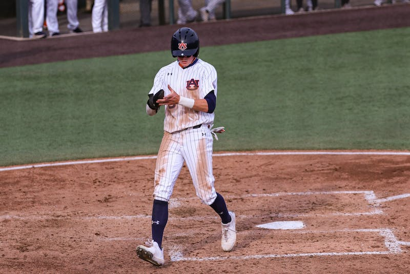 Mar 13, 2021; Auburn, AL, USA; Auburn Tigers infielder Bryson Ware (8) reacts after getting home during the game between Auburn and Little Rock at Auburn Arena. Mandatory Credit: Jacob Taylor/AU Athletics