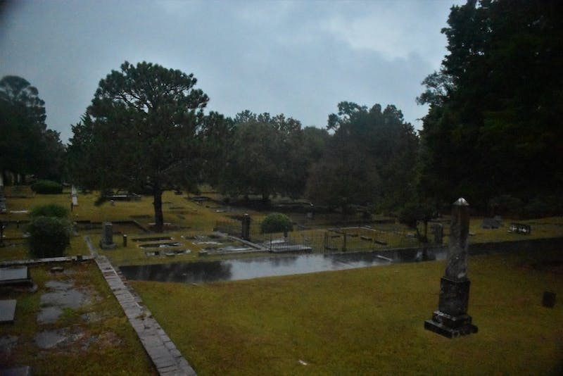 An overcast sky hangs over Pine Hill Cemetery in Auburn, Ala. on Oct. 15, 2019.
