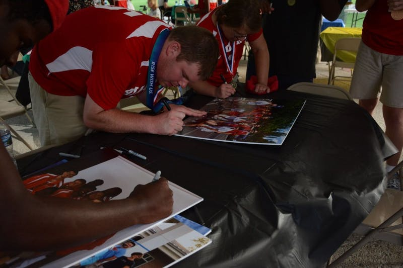 Lee County Special Olympics athletes sign their pictures from the USA Games on Thursday, July 26, 2018 at Kiesel Park in Auburn, Ala.