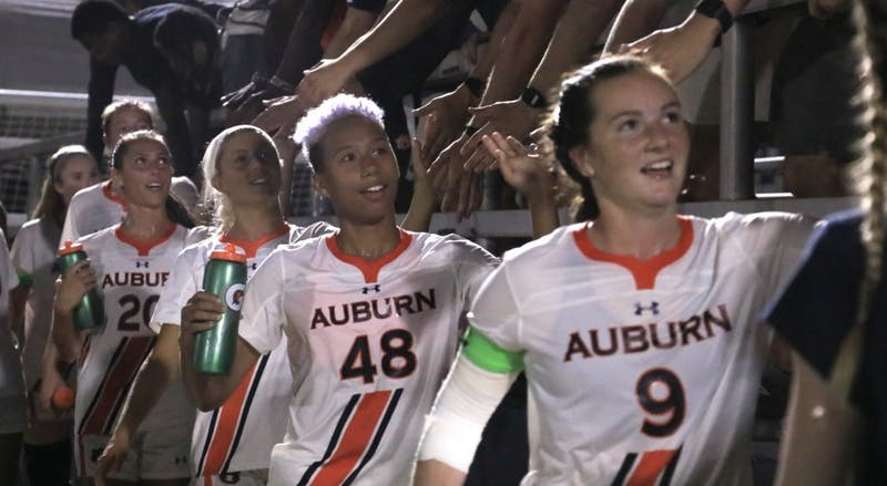 Auburn's Jaelyn Gadson (48) and Jessie Gerow (9) celebrate their win over Tennessee on Sept. 26, 2019, in Auburn, Ala.