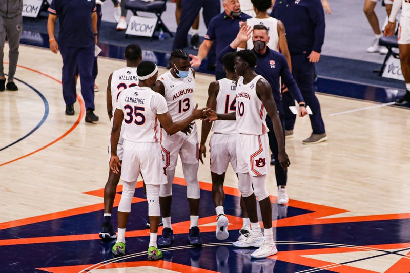 Mar 6, 2021; Auburn, AL, USA; The team reacts after a big play during the game between Auburn and Mississippi State at Auburn Arena. Mandatory Credit: Jacob Taylor/AU Athletics