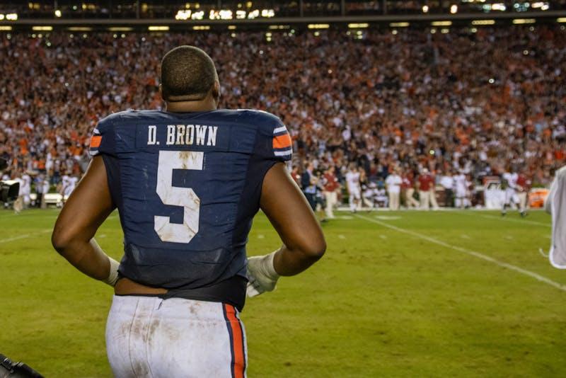 Derrick Brown (5) runs onto the field following Auburn Football's defeat of Alabama, on Saturday, Nov. 30, 2019, in Auburn, Ala.